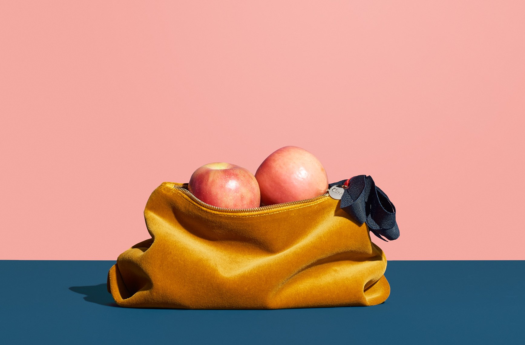 Gold Clare V clutch handbag with apples